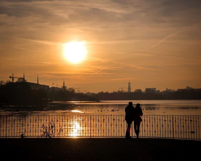 Love couple Sunset Silhouette Two People Sun Sky Togetherness Water Real People Rear View Walking Men Built Structure Full Length Leisure Activity Love Women Sunlight Bonding Outdoors Lifestyles Hamburg Außenalster Sunset_collection Sunrise_sunsets_aroundworld