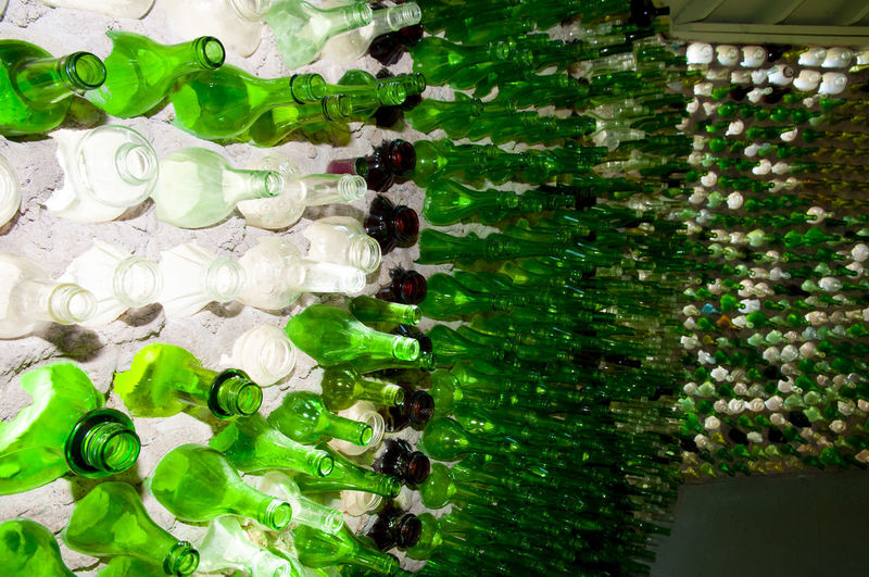 Close-up of green bottles on glass