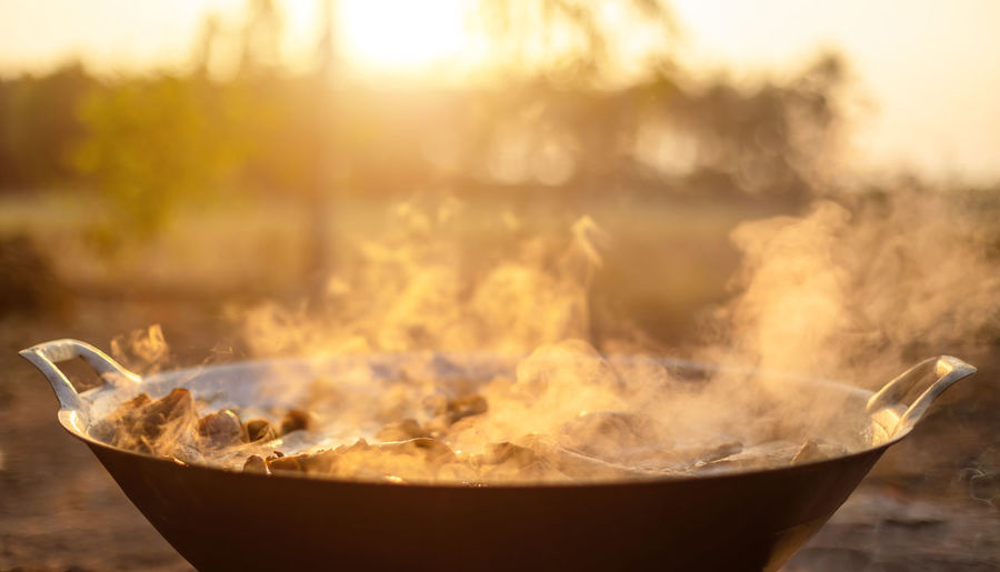 Close-up of fire in bowl at sunset