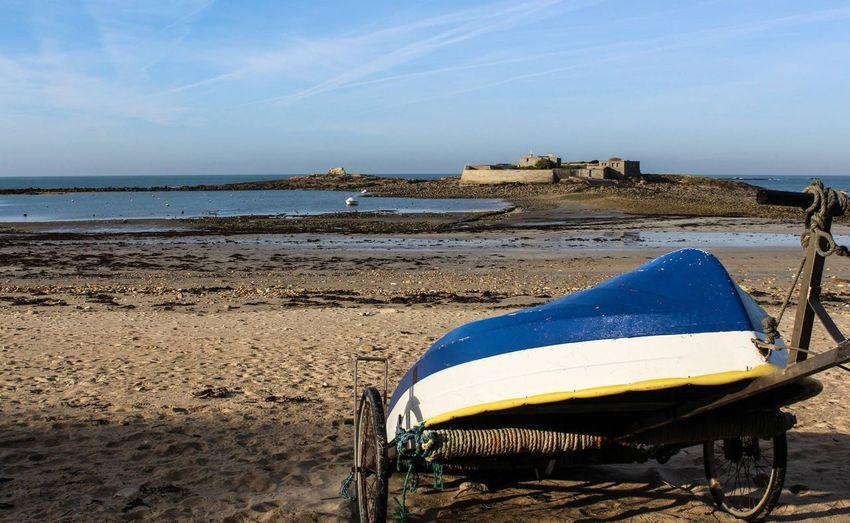Boat on push cart on beach
