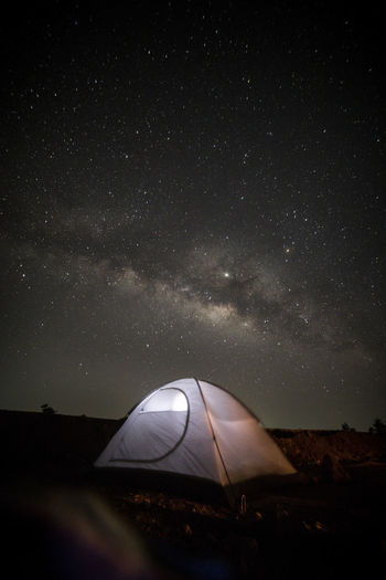 Tent on land against sky at night