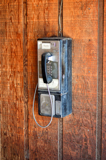 Telephone on wooden wall