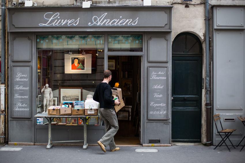 Architecture Book Shop Building Building Exterior Casual Clothing City Communication France Grey Person Shop Window