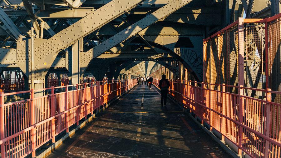 People on williamsburg bridge in city