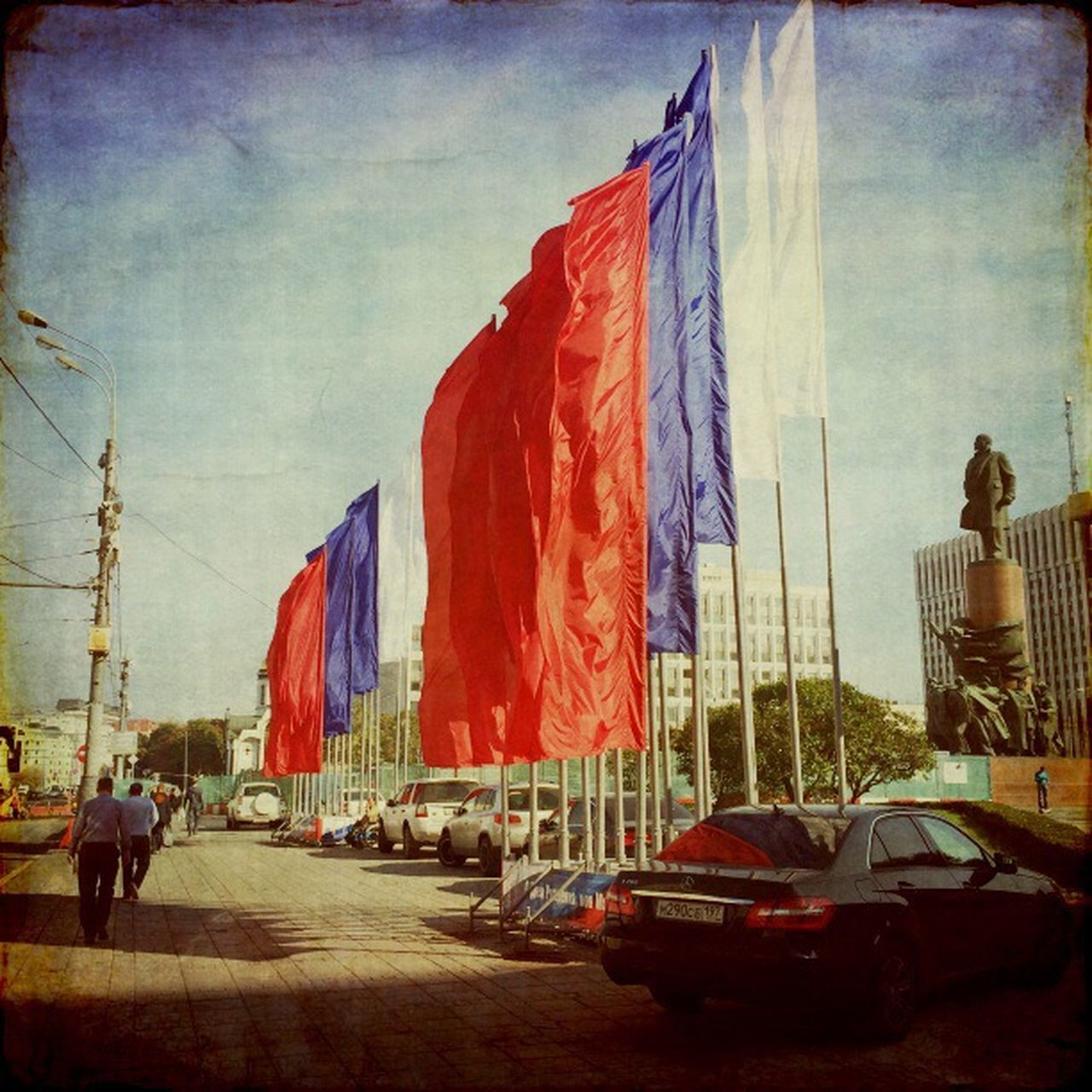 flag, car, architecture, built structure, building exterior, day, sky, real people, outdoors, city