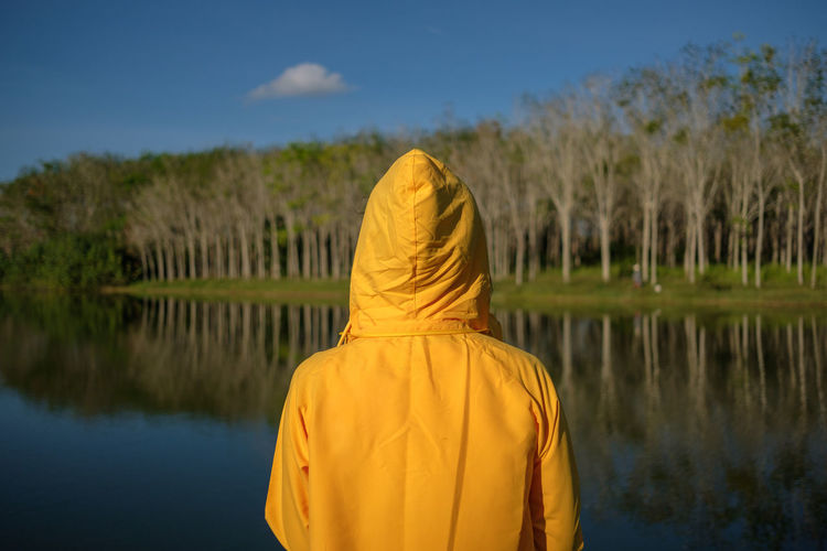 Holiday Weekend Adult Beauty In Nature Day Jacket Lake Long Mini Minimal Minimalism Nature One Person Outdoors People Real People Rear View Reflection Sky Summer Time Variation Water Women Yellow