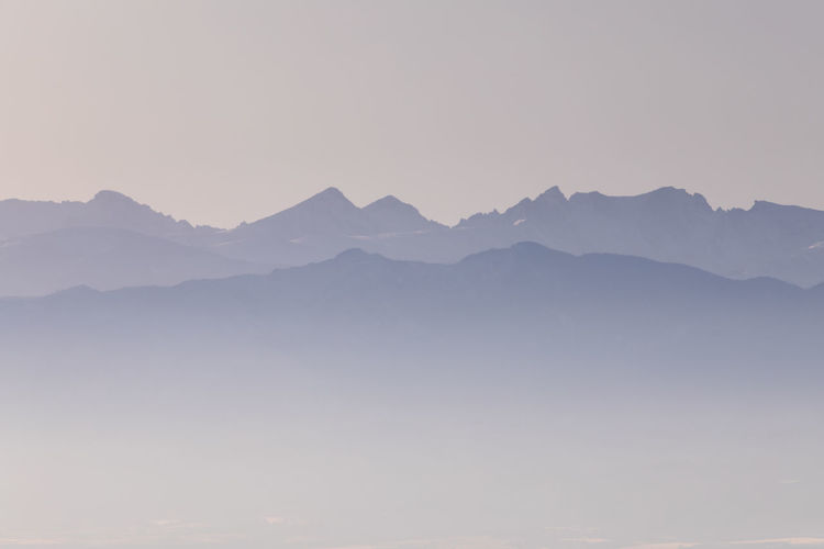 Mountain Beauty In Nature Scenics - Nature Tranquil Scene Tranquility Sky Mountain Range No People Environment Non-urban Scene Nature Idyllic Clear Sky Landscape Copy Space Majestic Outdoors Physical Geography Mountain Peak Hazy