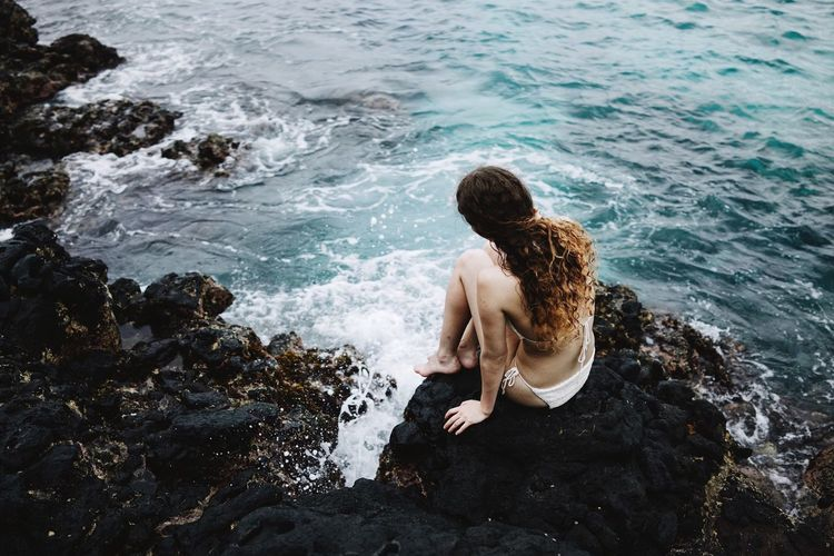 Cliffs Girl Rocks Volcanic Rock Black Rocks Sea Waves Surf Traveling INDONESIA Surf's Up The KIOMI Collection The Great Outdoors - 2016 EyeEm Awards People Of The Oceans