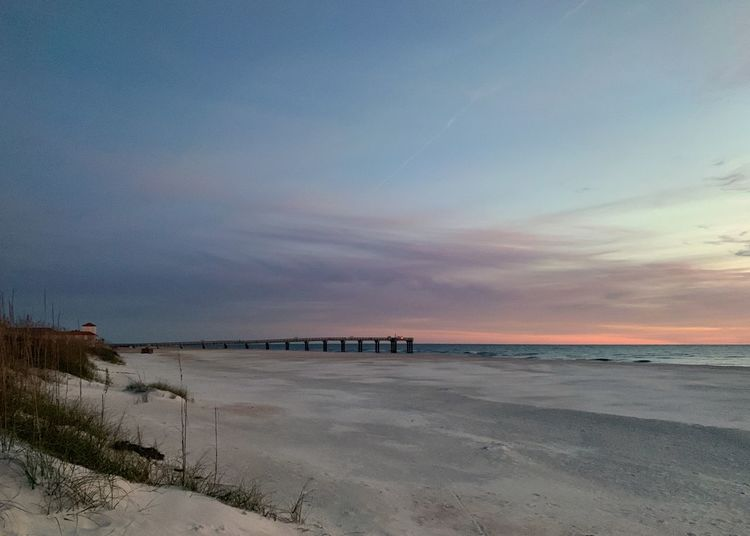Daybreak at Tempe beach with pier Sunrise Sand Dunes Dunes St. Augustine Beach Sea Sky Water Beach Land Scenics - Nature Beauty In Nature Tranquility Tranquil Scene Sand Nature Cloud - Sky Horizon Horizon Over Water Outdoors Low Tide Idyllic