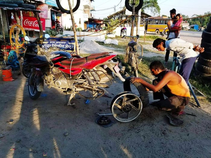 Sitting Bicycle Transportation Day Real People Outdoors Land Vehicle Men Full Length Beach Adult People Only Men Adults Only City Repair Shop Repairs Repair Work Repair Tools Repair Job Repairs Needed Repairing Puncture Repairing My Sanity
