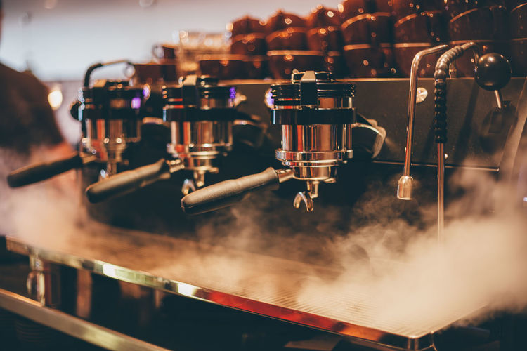 Close-up of steam emitting from espresso maker
