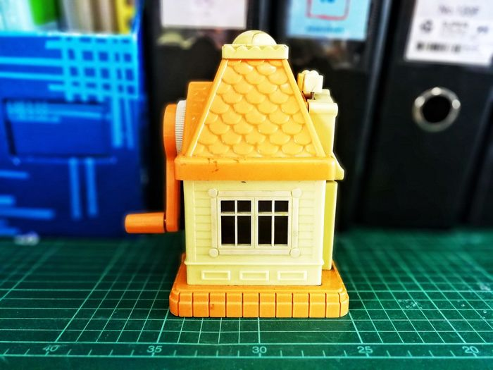 Close-up of yellow toy on floor in house