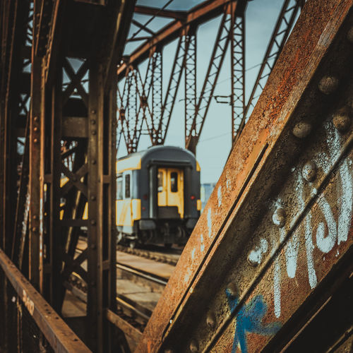 Close-up of train on railroad track against sky