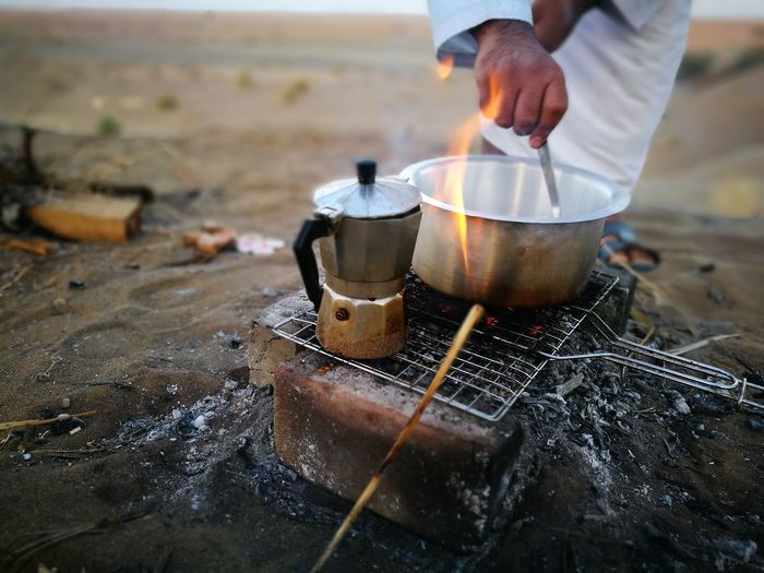 Man Preparing Coffee Outdoors