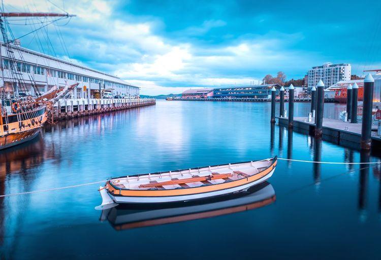 Blue hour in Houbart, Tasmania Reflection Sky Building Exterior Waterfront Calm Marina Ship Harbor