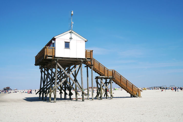 stilt house at the beach of St. Peter-Ording Architecture Built Structure Beach Incidental People Day Sand Lifeguard Hut Hut Outdoors St. Peter-Ording Sankt Peter-Ording Germany Vacation Spring Copy Space Travel Seaside North Sea Resort Schleswig-Holstein Stilt House Sunny