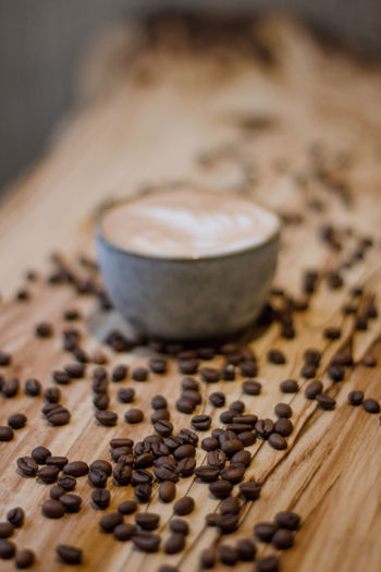 Coffee Coffee - Drink Coffee Cup Coffee Time Coffee Break Food And Drink Indoors  No People Selective Focus Still Life Drink Roasted Coffee Bean Table Freshness Food Refreshment Cup Mug Close-up Wood - Material Brown High Angle View Caffeine Non-alcoholic Beverage