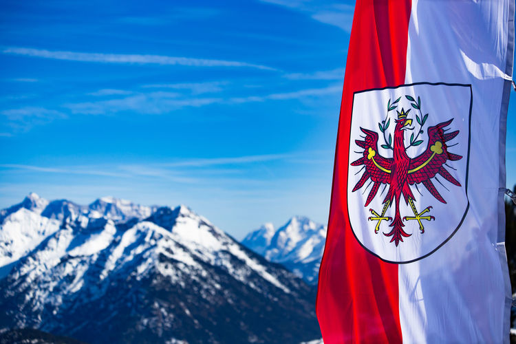 Flag Austria Mountain Snow Red Flag Winter Patriotism Cold Temperature Nature Beauty In Nature Day White Color Snowcapped Mountain No People Mountain Range Focus On Foreground Scenics - Nature Pride Environment Outdoors Austria