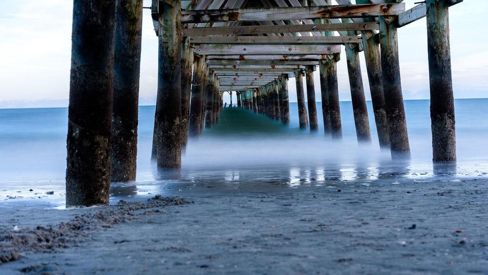 smooth ocean waves look like mist or fog beneath pier Pier Beach Fog Long Exposure Mist Ocean Sand Sea Water Waves EyeEmNewHere