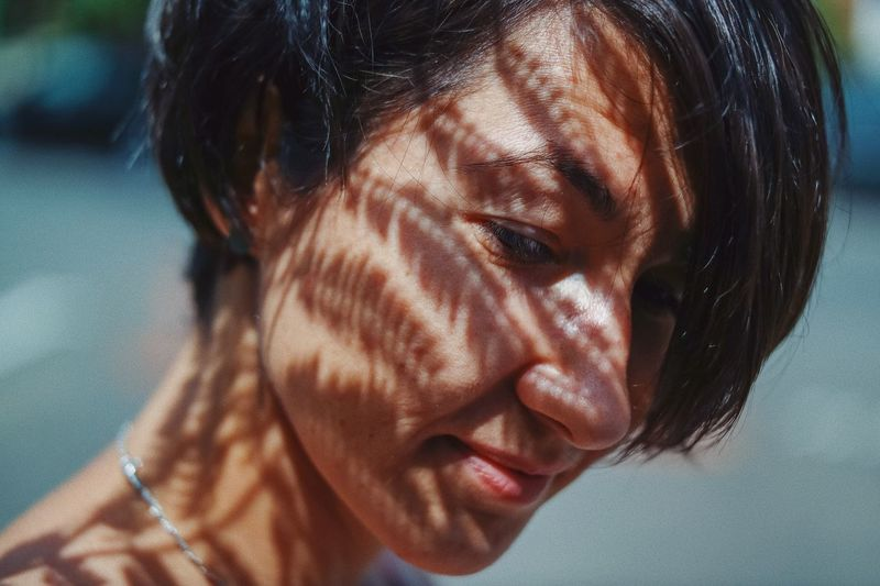 Nature's touch 🍃... Street Urban Thoughtful Haircut Hair Nature Shadow Patterns In Nature Pattern Skin Smile Happy Branch Lips Headshot Portrait One Person Close-up Real People Lifestyles Young Adult Body Part Human Body Part Young Women Looking Human Face Women Hairstyle Contemplation Sunlight International Women's Day 2019