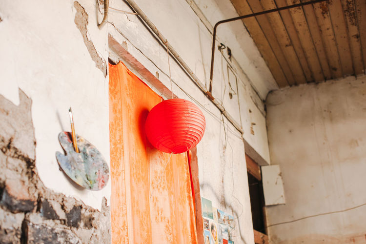 Low angle view of chinese lantern on old house door