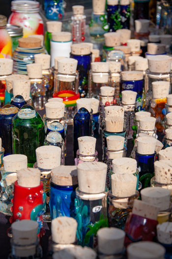 Full frame shot of multi colored bottles for sale at market