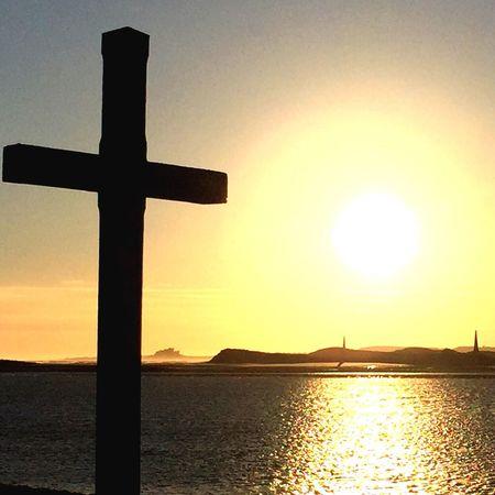 Easter Ready Spirituality Lindisfarne St Cuthberts Sunrise Cross Jesus Religion Beautiful Beauty In Nature Sea Sea And Sky Silhouette Sun Sunrise_Collection Tranquility Tranquil Scene Silhouettes