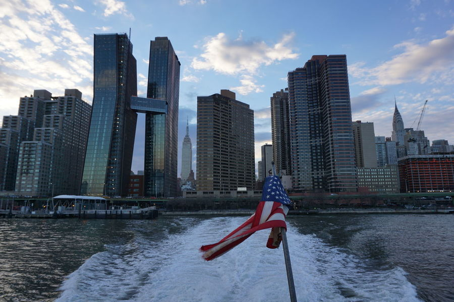 America American Flag Architecture Building Exterior Built Structure City Day Flag Harbor Modern Nautical Vessel New York New York City No People Outdoors Sea Sky Skyline Skyscraper Travel Travel Destinations Travel Photography Traveling Urban Skyline Water