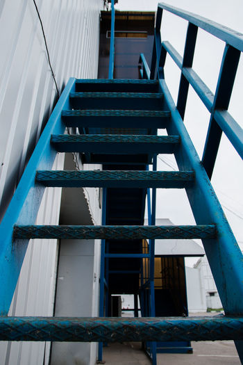 Blue stairs Architecture Built Structure Blue Staircase No People Metal Day Low Angle View Building Building Exterior Railing Outdoors Empty Nature Industry Direction Sky Window Old Directly Below