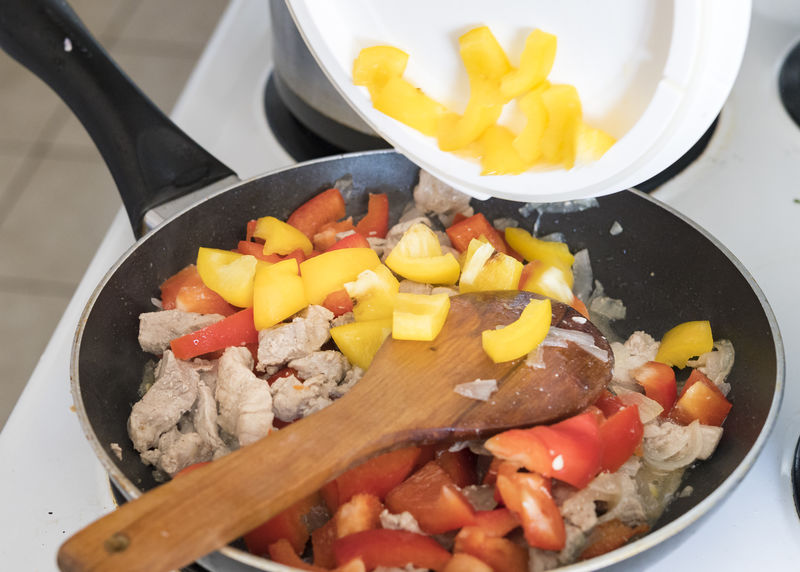 Cuban cuisine: pork tip steak in a cooking pan with red peppers and adding yellow peppers Close-up Cooking Cooking Pan Food Freshness Green Pepper Green Peppers Health High Protein Indulgence Kitty Meal No People Pork Pork Tip Stea Pork Tip Steak Portrait Red Peppers Serving Size Still Life Tip Stea Vegetables Yellow Peppers