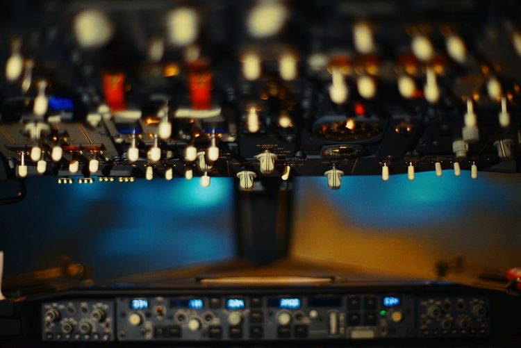 Empty illuminated airplane cockpit at night
