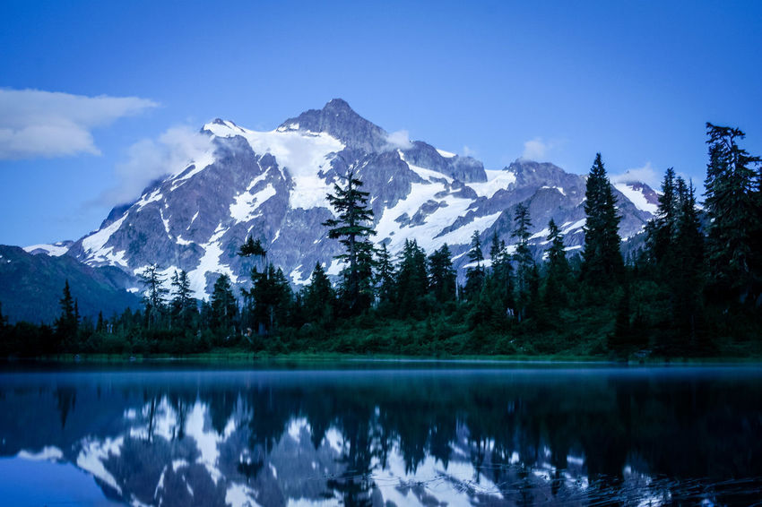Beauty In Nature Blue Cold Temperature Day Lake Landscape Mountain Mountain Range Nature No People Outdoors Range Reflection Scenics Sky Snow Snowcapped Mountain Tranquil Scene Tranquility Tree Water Winter
