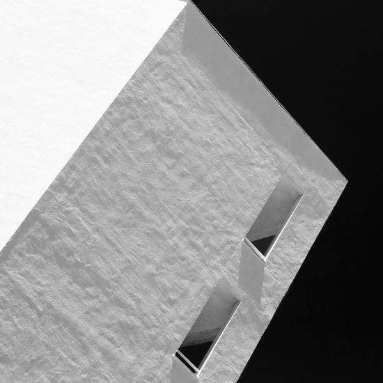 A hotel corner Abstract Architectural Detail Architectural Feature Architecture Architecture Black & White Black And White Minimalist Architecture Built Structure Day Directly Below Geometric Shape High Section Low Angle View Modern Nature No People Outdoors Part Of Sky White Window Fine Art Photography Pivotal Ideas The Graphic City