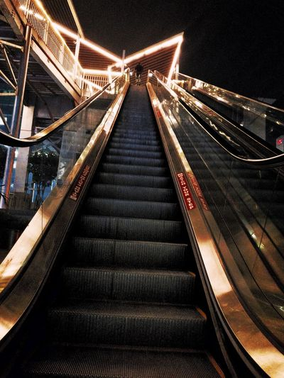 Escalators Photography Staircase Stair Steps Wide Guidance Wood Architecture Subway Steep Copy Space Wide Shot Wide Angle New People Color Image Locomotive Travel Night Escalator EyeEm Selects Illuminated Night The Way Forward Steps And Staircases Built Structure Architecture No People Indoors  City
