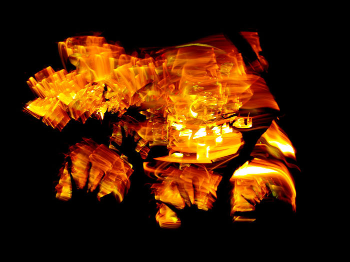Close-up of fire burning against black background