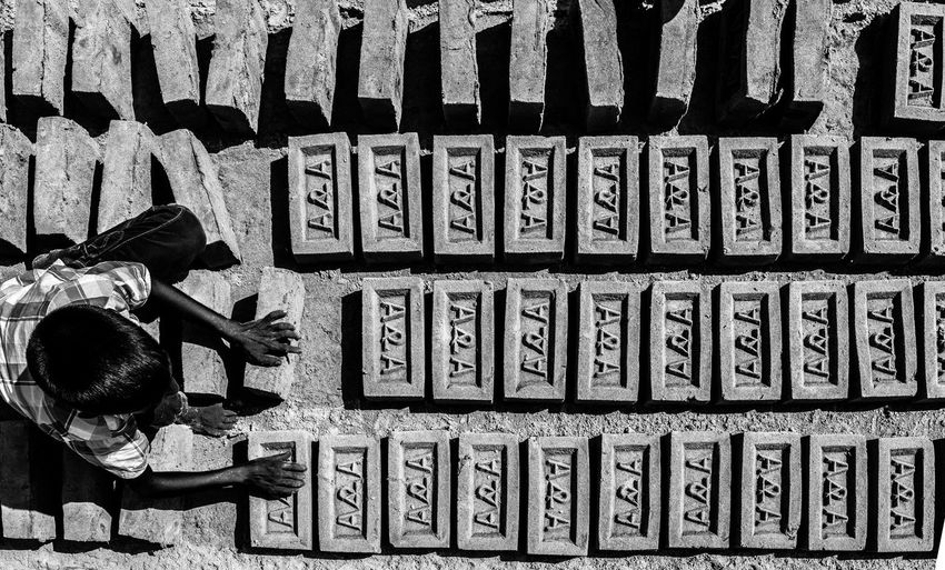 Pattern Text Day Outdoors Full Frame EyeEm Selects For Sale EyeEmNewHere Cover Lifestyles Connected By Travel Rethink Things Child Labour Bricks Repetation Be. Ready. Outdoors Photograpghy  Ariel View Black And White Friday Black And White Friday