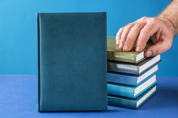 Close-up of hand on book