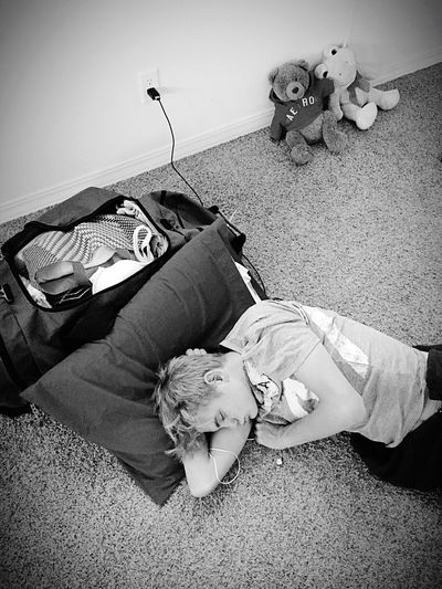 My sleeping son after movers packed everything Son Teenager Sleeping Moving Stuffed Animals Luggage Sleeping On The Floor