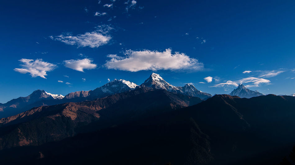 This Annapurna Mountain range photo was taken at Poonhill, Nepal, Annapurana, Eyeempokhara Hiking Poonhil Trek Beauty In Nature Blue Cloud - Sky Cloud, Day Eyeemnepal Fishtail  Landscape Majestic Mountain Mountain Range Nature No People Outdoors Scenics Sky Snow Snowcapped Mountain Tranquil Scene Tranquility Trekking,