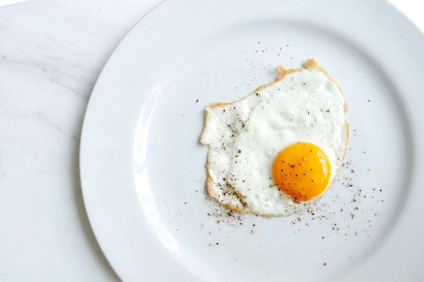 Paint The Town Yellow Plate Food And Drink Egg Directly Above Food Breakfast White Background Table No People Indoors  Freshness Fried Egg Close-up Healthy Eating Egg Yolk Ready-to-eat The Week On EyeEm