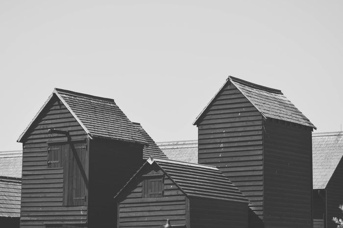 Architecture Black & White Black And White Building Exterior Built Structure Clear Sky Day Fishermans Shop Low Angle View Monochrome Net Shops No People Outdoors Roofscape Sky Timber Frame Timber Framed