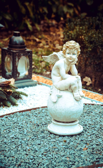 Sculpture Art And Craft Statue Representation Human Representation Religion No People Creativity Spirituality Belief Day Male Likeness Craft Architecture Solid Close-up Focus On Foreground Outdoors Nature Ornate