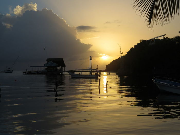 Beauty In Nature Boat Island Island Life Moored Nautical Vessel Roatan Roatan Honduras Roatan Island Roatan, Honduras Roatanhonduras Sun Sunbeam Sunset Tranquil Scene Tranquility Travel The World Water Waterfront