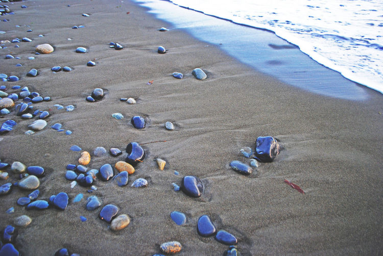 High angle view of stones at beach