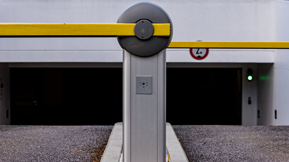 entrance barrier Darkness Entrance Entry Modern Architecture Wall Barrier Bound  Communication Day Entrance Barrier Limit Modern Building No People Outdoors Underground Parking Yellow