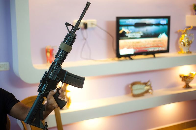 M-16 held by his owner at his house Indoors  Home Gun M-16 Machinegun Defence Culture House Family Safety Homemade Home Sweet Home Fight Rights Documentary EyeEmNewHere Lifestyle