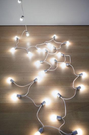 Close-up of illuminated lights on tiled floor