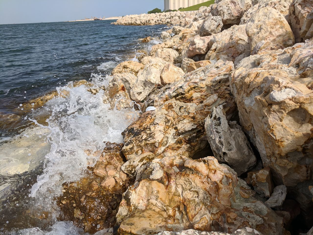 water, sea, rock, rock - object, solid, motion, beach, land, nature, beauty in nature, no people, scenics - nature, wave, rock formation, sport, day, outdoors, aquatic sport, tranquility, power in nature, rocky coastline, breaking