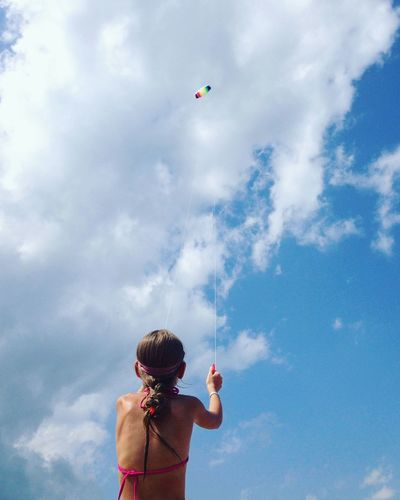 Cloud - Sky Sky Childhood Child Flying Nature One Person Rear View Offspring Outdoors Lifestyles Low Angle View Kite Blue Day Real People Leisure Activity Nature Waist Up Freedom Rear View Kite - Toy Holding Mid-air Standing Low Angle View