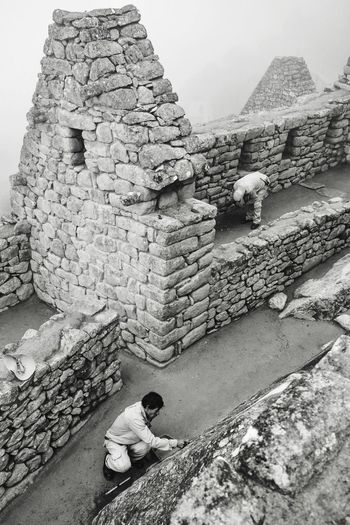 Jenga // Macchu Picchu Peru Streetphotography Reportage Jenga Monochrome Travel Blackandwhite Mirrorless Olympus Ruins Landmark History Real People Architecture Built Structure Old Ruin Outdoors Day Ancient One Person Men Ancient Civilization Nature